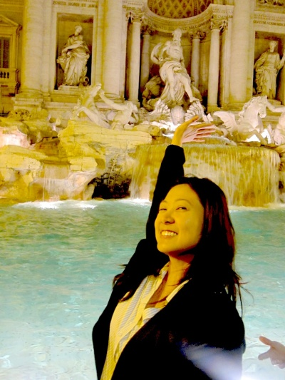 Three coins in the fountain. Trevi Fountain, Rome.